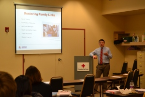 Cody teaches local law students about the Restoring Family Links program.