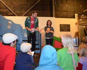 Ari and Emily teach young museum-goers about fire safety.