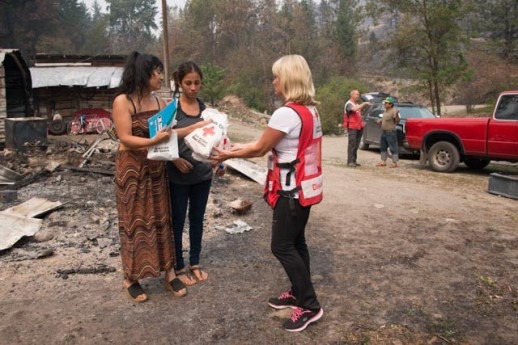 Red Cross volunteers providing comfort kits and other supplies to people whose home was destroyed by the wildfires. Photo Credit: Maggie Buckenmayer/American Red Cross