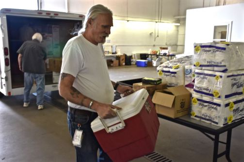 Red Cross volunteers Steve Taylor and Mike Mcknight unload and inventory a trailer full of kitchen supplies at the wildfire disaster headquarters in Wenatchee, Washington. Even while the current disaster response is still underway, they are in preparedness mode, working to make sure that all kitchen supplies are in hand and ready for the next disaster.