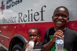 August 21, 2016. Eunice, Louisiana. Brothers Dejon, 7, and Daquan, 4, are among the children impacted by the flooding. Red Cross relief supplies distribution event, Eunice, St. Landry Parish, Louisiana. Photo by: Marko Kokic/American Red Cross