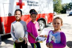 October 26, 2016. Lumberton, North Carolina. Kendrick, Katlynn and Savannah are eager to eat lunch during clean up efforts from severe flooding in Lumberton, NC. Their home was severely damaged by floodwater and without power in the area they look forward to the visits from the Red Cross. Photo by Daniel Cima for the American Red Cross