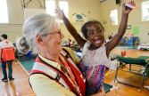 October 27, 2016. Fair Bluff, North Carolina. Ohio volunteer Mary Martin spends time with shelter resident DonDra Worhey, 3, in Fair Bluff, NC. Photo by Daniel Cima for the American Red Cross