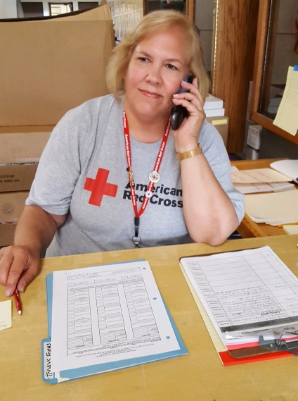 volunteer-kathy-brasch-welcomes-evacuees-to-the-shelter.jpg