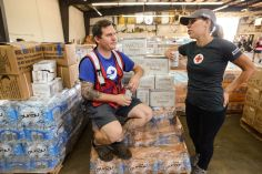 September 26, 2018. Fayetteville, North Carolina. Volunteers in the Fayetteville Warehouse work hard to load up the 14 trucks going out from that location in the morning to get them ready to go out to the community. Photo by Daniel Cima/American Red Cross